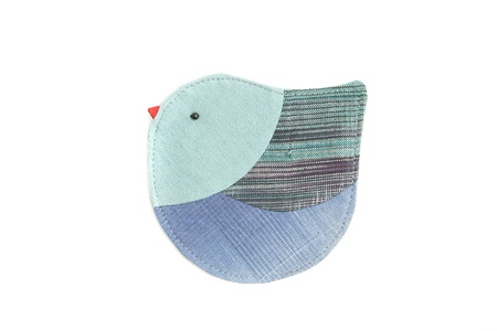 cute bird sew by cloth isolated on a white background photo