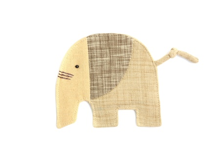 cute elephant sew by cloth isolated on a white background photo