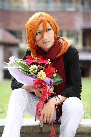 CHIANGMAI, THAILAND - NOV 27: Cosplay festival in Chiangmai.Man waiting with rose On December ,2011 in Chiangmai, Thailand.