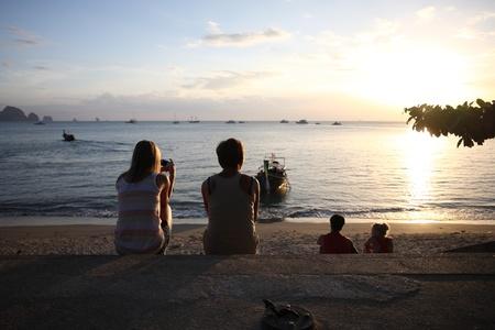 people on beach in sunset