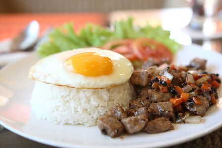 black pepper: roast beef with black pepper and fried egg on rice Stock Photo
