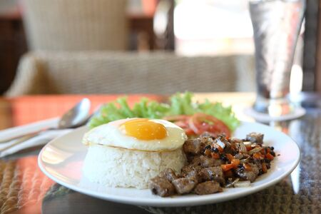 roast beef with black pepper and fried egg on rice photo