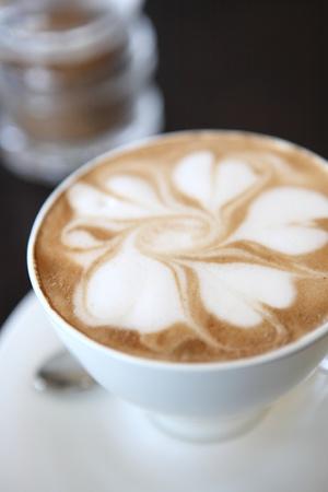 coffee spoon: coffee on wood background