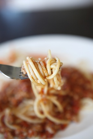 spaghetti with pork in tomato sauce photo