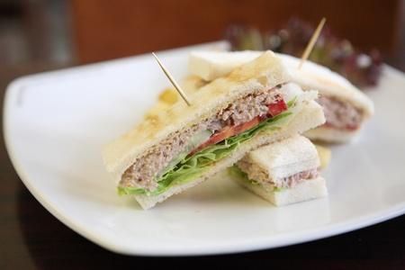 tuna mayo: tuna sandwich on wood background