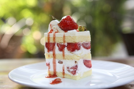 Strawberry Cake on wood  Stock Photo - 12555219