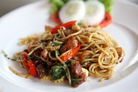 Spaghetti spicy with basil  photo