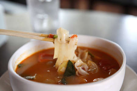 Tom Yum soup Thai traditional spicy prawn soup with noodle photo