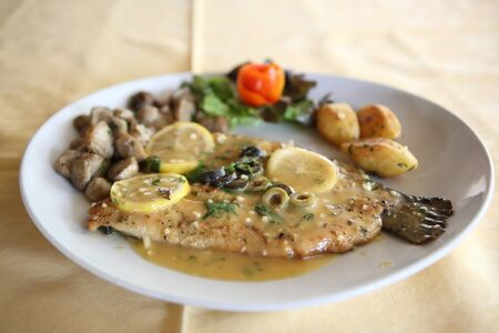 trout fish with lemon sauce photo
