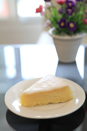slice of lemon cheese cake with flower photo