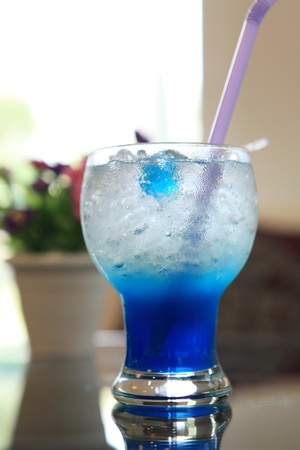 blue cocktail martini with flower photo