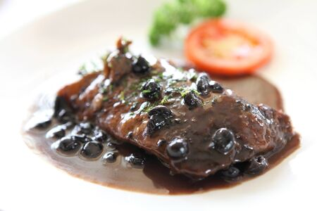 Duck confit , Roasted duck with blueberry sauce photo