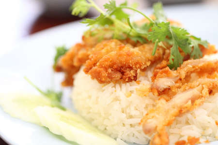 Thai food gourmet fried chicken with rice , khao mun kai tod in wood background  photo