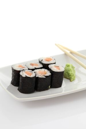 Salmon Maki sushi with chopsticks  photo