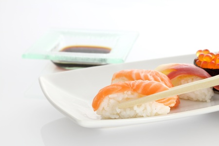 sushi with chopsticks in white background photo