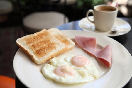 Breakfast with ham , fried egg and bread photo