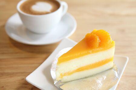 Orange cake on wood background Stock Photo - 15535662