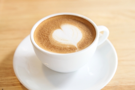 cappuccino: coffee on wood background
