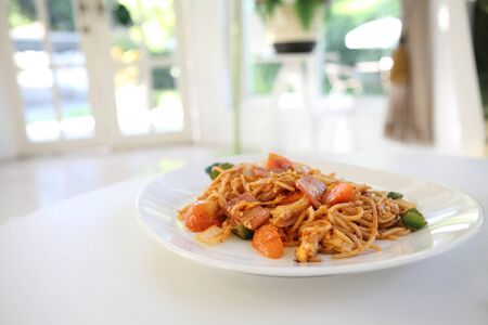 Spaghetti with ham and tomato sauce photo