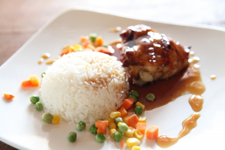 Grilled Chicken teriyaki rice on wood background photo