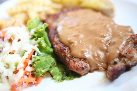 Grilled Porkchop with white sauce  photo