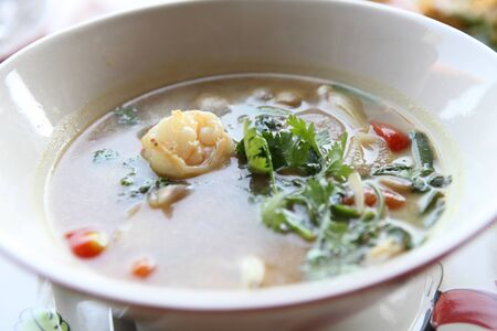 Thai traditional spicy prawn soup , Tom yum kung with rice photo