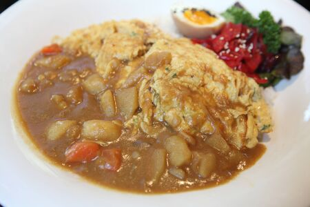 Curry rice with omelet photo
