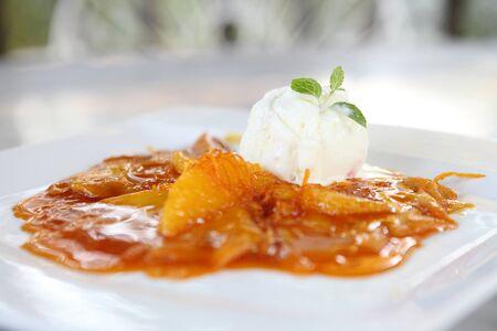 Crepe with orange sauce and icecream photo