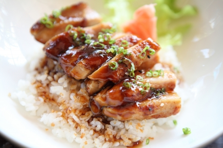 chicken meat: Grilled Chicken teriyaki rice on wood background
