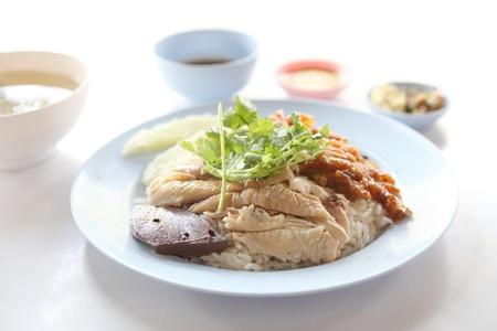 La comida tailandesa gourmet de pollo con arroz al vapor, Khao mun kai photo