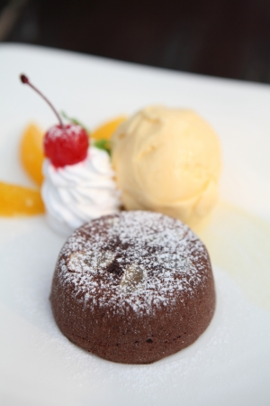 Chocolate Lava Cake with ice cream and fruit photo