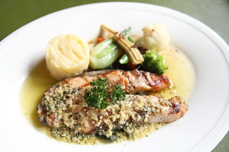 Grilled Salmon Steak with vegetables photo
