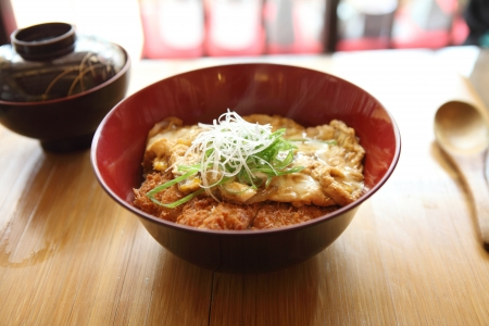 Katsudon - Japanese breaded deep fried pork cutlet (tonkatsu) topped with egg on  rice photo