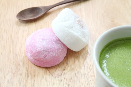 mochi with green tea photo