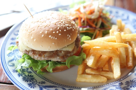 hamburger with fries and salad photo