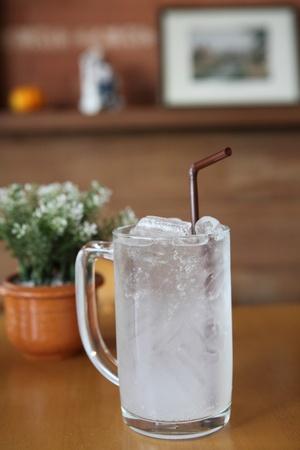 lychee soda on wood background photo