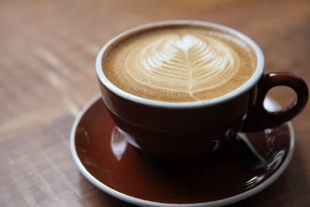 cappuccino foam: coffee on wood background
