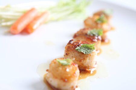 seared: close up of pan seared sea scallops