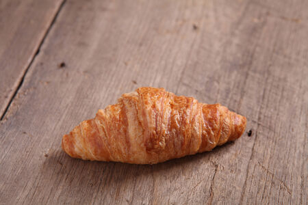 croissant on wood background photo