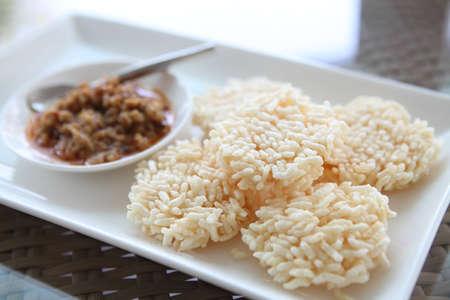 Thai food rice crust with pork spicy sauce