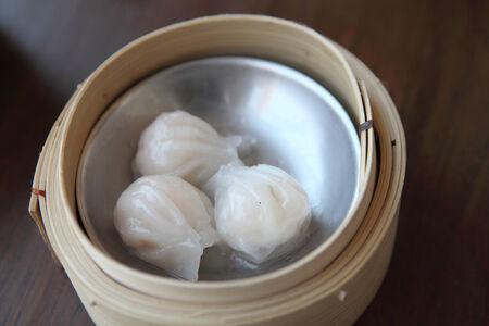 dim sum: yumcha , dim sum in bamboo steamer