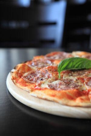 unsliced: Pepperoni pizza  Stock Photo