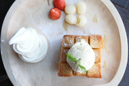 french toast with ice cream and fruit photo
