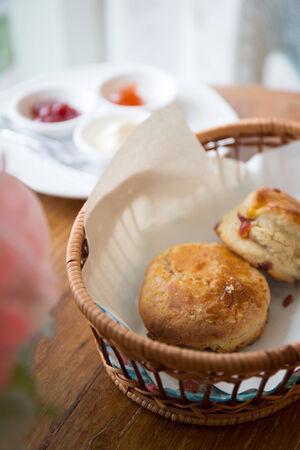 scones tea with strawberry jam photo