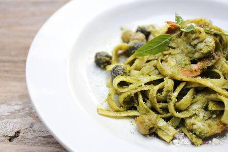 spaghetti with pesto sauce photo