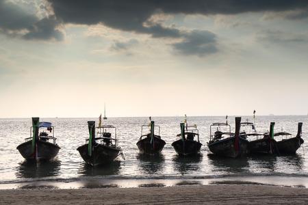 Thai boat in sunset photo