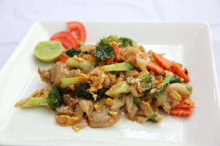Thai food fried noodle with egg and pork photo