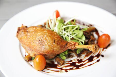 canard: Duck confit , Roasted duck with blueberry sauce