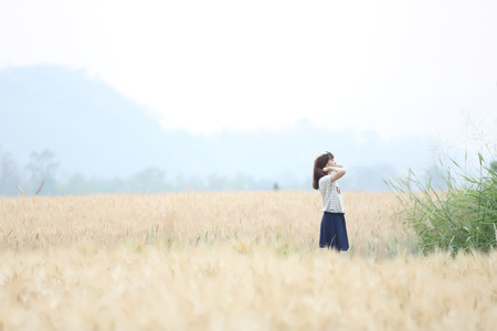 Young woman in wheat photo