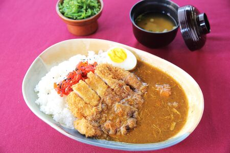 Curry rice with fried pork photo